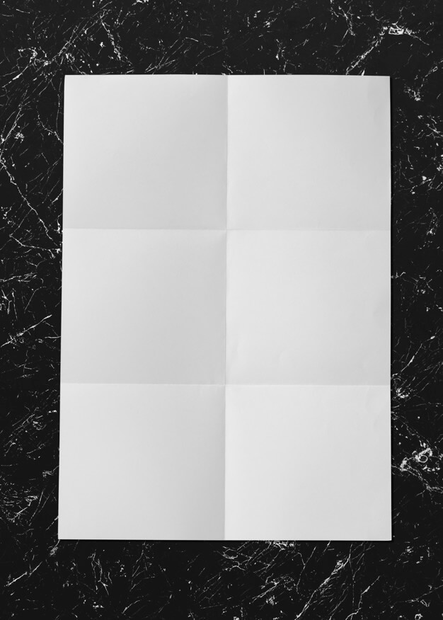White folded paper on marble mockup Free Psd