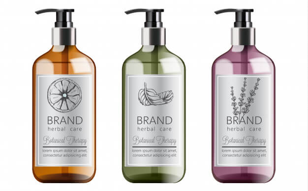 Bottles of organic shampoo with herbal care. various plants and colors. mint, orange and lavender Free Vector (1)