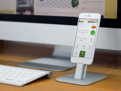 Mockup of a White iPhone 6 on a Standing At The Office