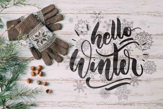 Top view hello winter with warm gloves Free Psd
