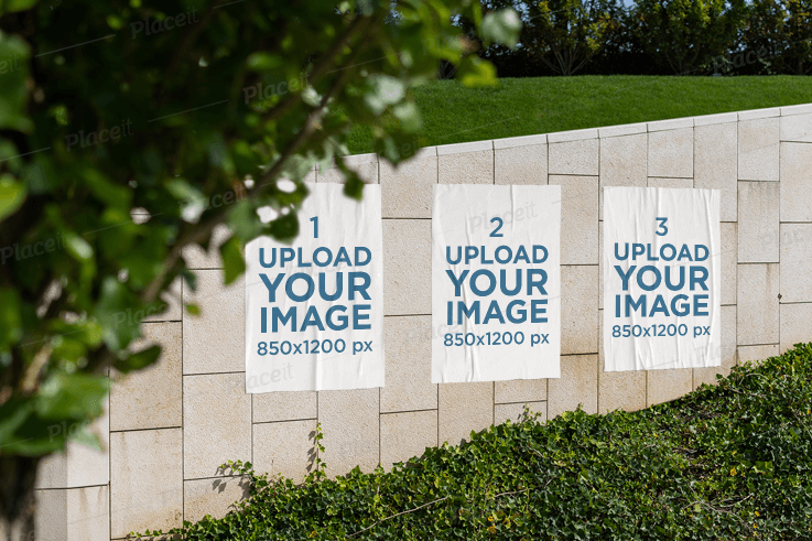 Mockup of Three Paper Posters on a Wall