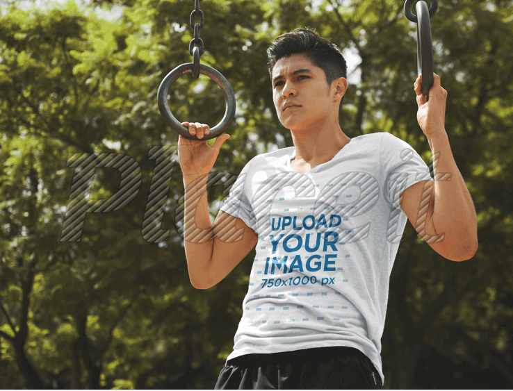 Sports T-Shirt Mockup of a Man Exercising on Gymnastic Rings