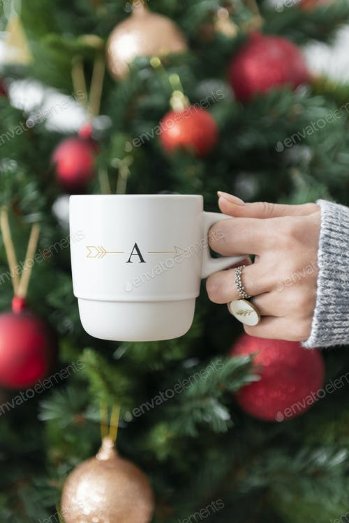 Hand Holding White coffee mug mockup For Quote