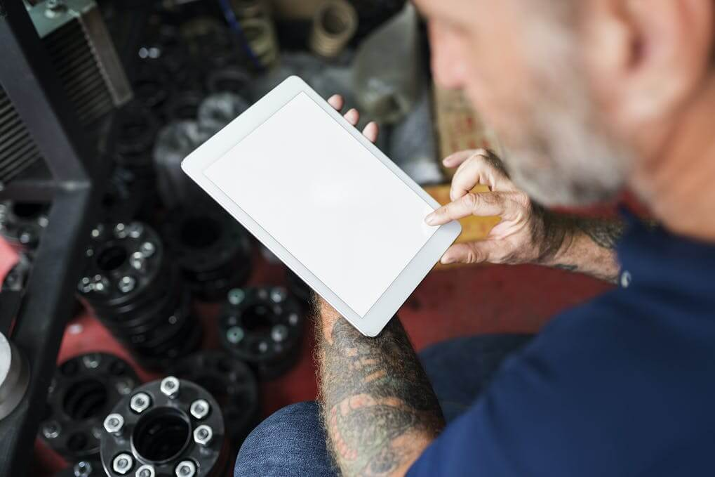 Man with Tattoo Using Tablet Mockup