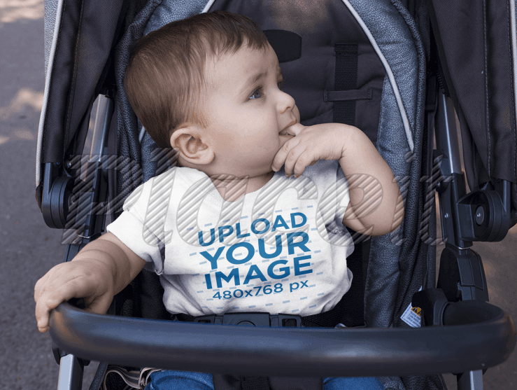 Mockup of a Baby Boy Wearing a Round Neck Tshirt Template While on his Stroller